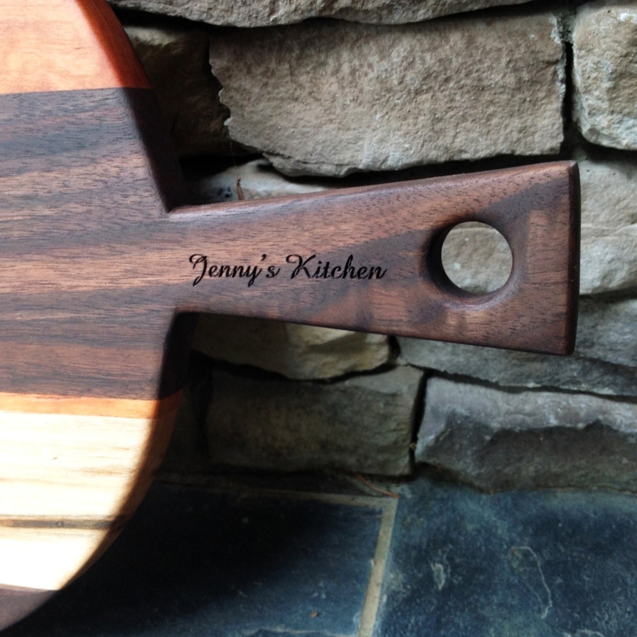 Beautiful cherry, walnut and ambrosia maple French Larder charcuterie cutting board with engraving handcrafted by Michael's Woodcrafts Greenville SC woodworking woodartist